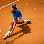Rafael Nadal slides into a forehand.