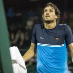Feliciano Lopez argues with the umpire during a rain-delayed quarterfinal match.