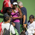 Venus and Serena Williams say hello to Rafael Nadal.