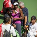 Venus and Serena Williams say hello to Rafael Nadal.