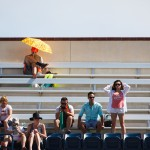 A fan tries to keep cool in the California sun.