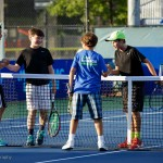 Academy students finish their doubles match.