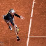 Kristina Mladenovic runs down a forehand